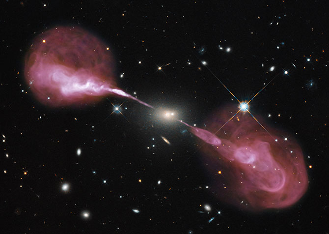 Spectacular jets powered by the gravitational energy of a super massive black hole in the core of the elliptical galaxy Hercules A.