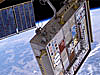 MISSE experiment hanging from the space station above Earth
