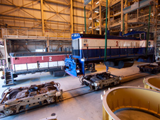 An overhead crane in the RPSF lifts NASA locomotive No. 3 off of its trucks