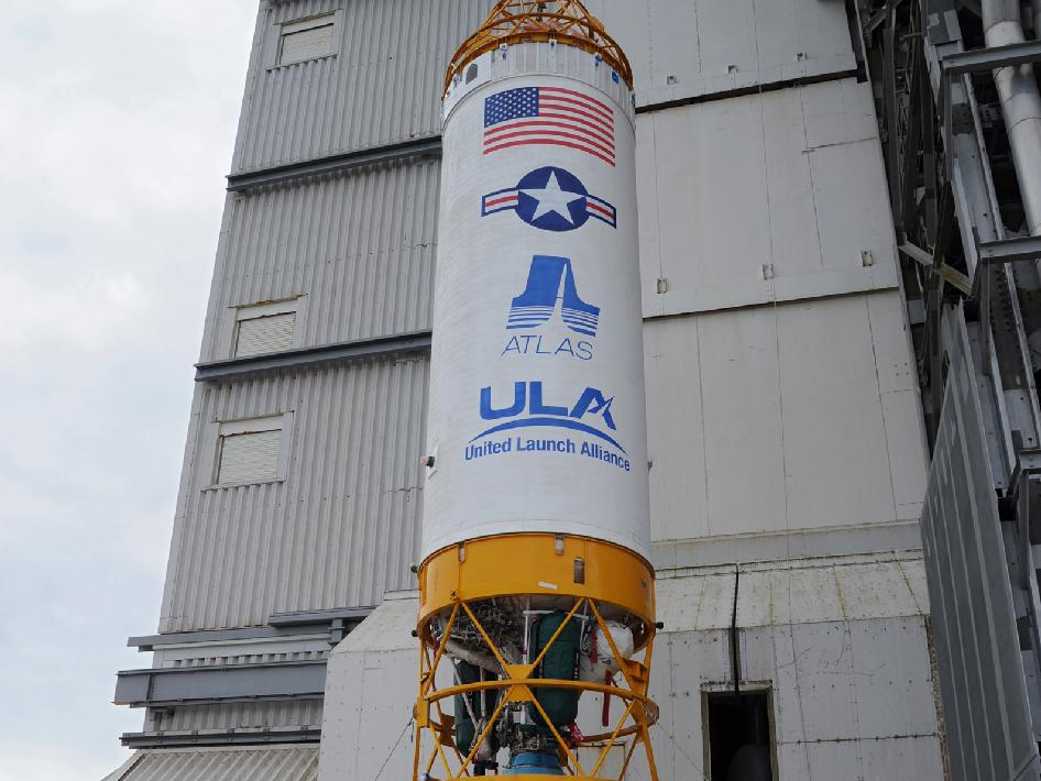 Centaur upper stage is lifted at the launch pad.
