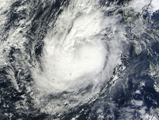 MODIS satellite captured this visible image of Typhoon Bopha moving through the South China Sea on Dec. 6