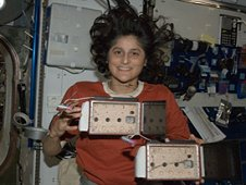 Astronaut Suni Williams with the YouTube SpaceLab payload Spider Habitat where Nefertiti the spidernaut lived while she was on orbit. (NASA)