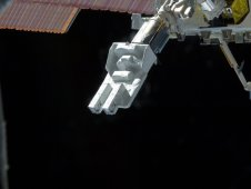 The JEM Small Satellite Orbital Deployer being released from the airlock and extended into space in preparation to jettison satellites from the International Space Station. (NASA)