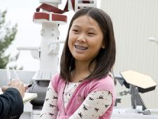 Clara Ma posing for a photo next to the Mars rover, Curiosity
