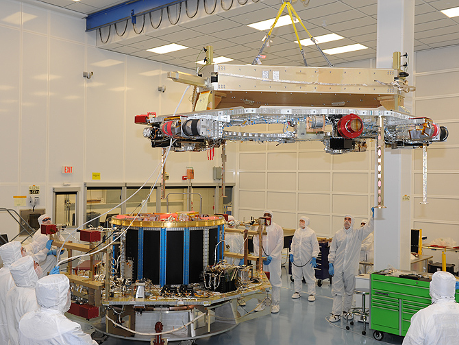 Engineers using a special crane installed the instrument deck onto NASA's MMS Structure 2 in the early hours of December 11, 2012.