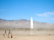 The Xaero reusable launch vehicle takes off during a free flight test at the Masten facilities in Mojave, Calif.