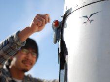 Jonathan Powers of Masten secures Xaero hardware prior to a flight test.