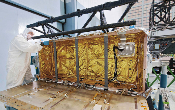 The James Webb Space Telescope's IEC is all wrapped up in a thermal blanket, and looking like a holiday package at a cleanroom in Goddard.