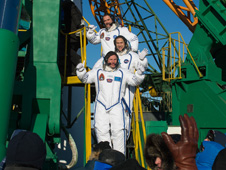 201212190010hq -- Expedition 34 Flight Engineers Chris Hadfield (top), Tom Marshburn (middle) and Roman Romanenko