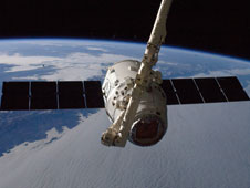 ISS033-E-011151: Canadarm2 grapples Dragon spacecraft