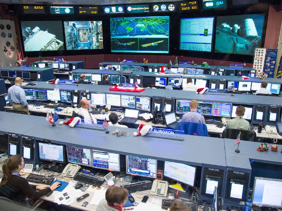 Flight controllers in the space station flight control room