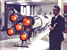 Jesco von Puttkamer stands beside a model of the Saturn V rocket. Credit: NASA