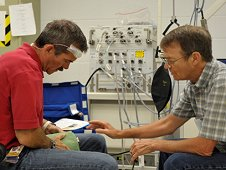 Canadian Space Agency Astronaut Chris Hadfield (left) undergoing preflight training on the BP Reg experiment with lead researcher, Richard Hughson, Ph.D. (right). (CSA)