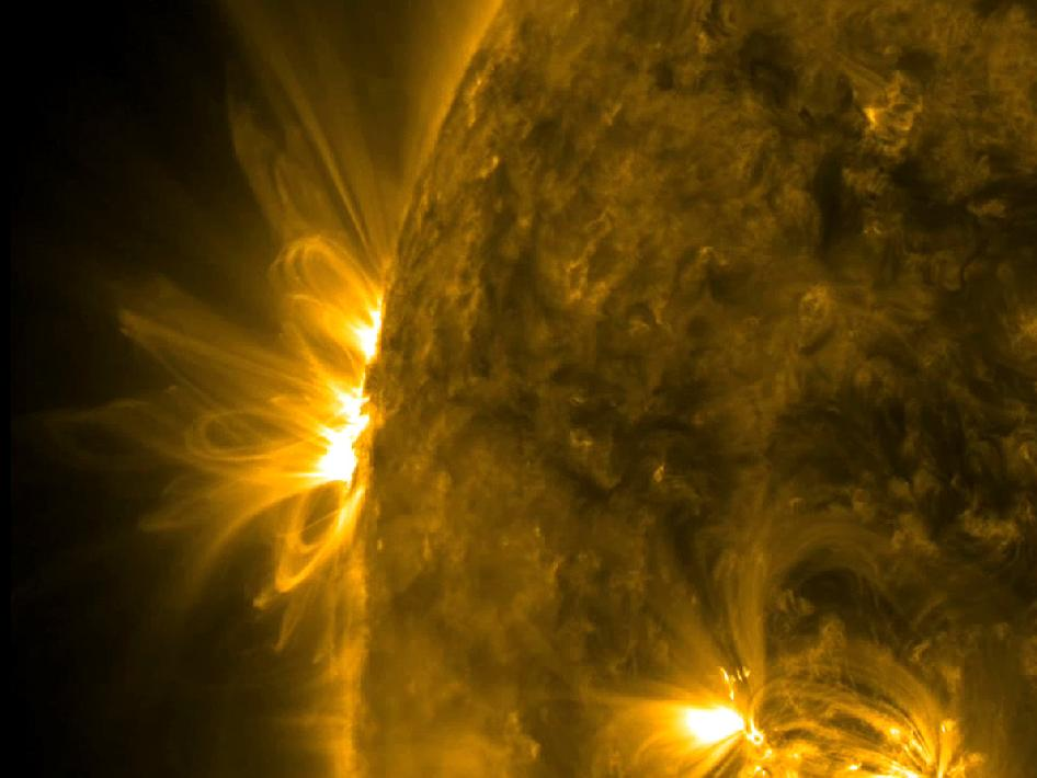 A dynamic active region is coming into view with scads of spurting plasma and magnetic loops darting and blossoming above it (Dec. 16-18, 2012).