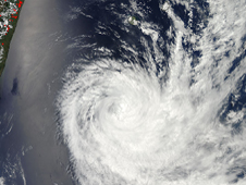 This visible image from NASA's Aqua satellite shows Tropical Cyclone Dumile has moved south of La Reunion Island and Mauritius on Jan. 4, 2013