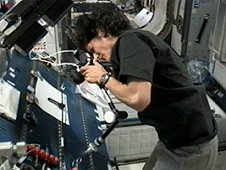 NASA astronaut Suni Williams photographing InSPACE-3 vial assembly after particles redistribution operation on the International Space Station. (NASA)