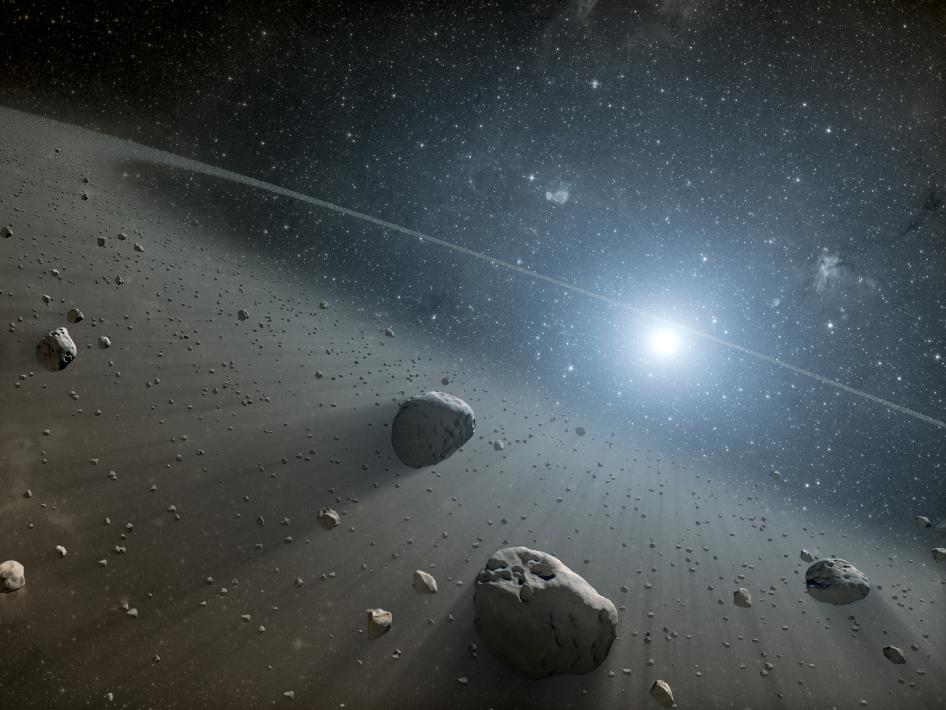 Artist's concept illustrates an asteroid belt around the bright star Vega