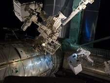 On July 12, 2011, spacewalking astronauts Mike Fossum and Ron Garan successfully transferred the Robotic Refueling Mission, or RRM, module from the Atlantis shuttle cargo bay to a temporary platform on the International Space Station's Dextre robot.  (NASA)