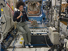 Astronaut Suni Williams talks on a microphone while on the space station