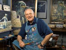 alan bean sitting in front of his paintings