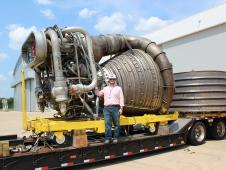 A Saturn V F1 engine arrives at Marshall Space Flight Center.