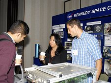 Exhibitors from NASA's Kennedy Space Center in Florida display test models of biological research equipment for the space station. (ASGSR/Janet Powers)