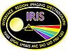 Mission patch with the sun, a prism and a rainbow