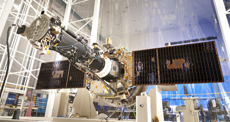 The fully integrated spacecraft and science instrument for IRIS mission is seen in a clean room.