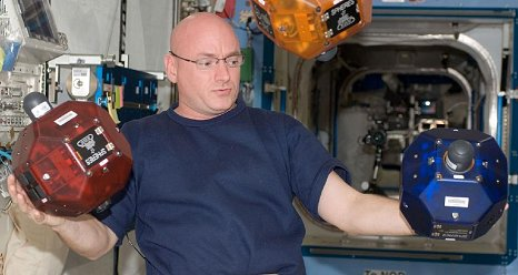 NASA astronaut Scott Kelly, Expedition 25 flight engineer, is pictured near three Synchronized Position Hold, Engage, Reorient, Experimental Satellites (SPHERES) floating freely in the Kibo laboratory of the International Space Station. (NASA)