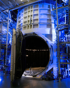 vertical image of the massive atmospheric testing chamber imposed over a blurred horizontal version for visual effect. Lots of blue, white and steel