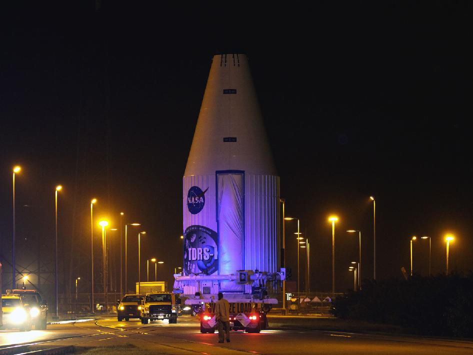 The payload fairing with the TDRS-K satellite moves to the launch pad aboard a truck.