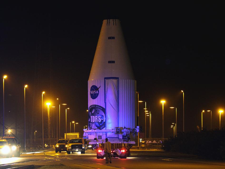 NASA's Tracking and Data Relay Satellite, TDRS-K, enclosed in its payload fairing, passes through the Launch Complex 39 area at NASA's Kennedy Space Center as it travels from the Astrotech payload processing facility in Titusville, Fla., to its launch site.