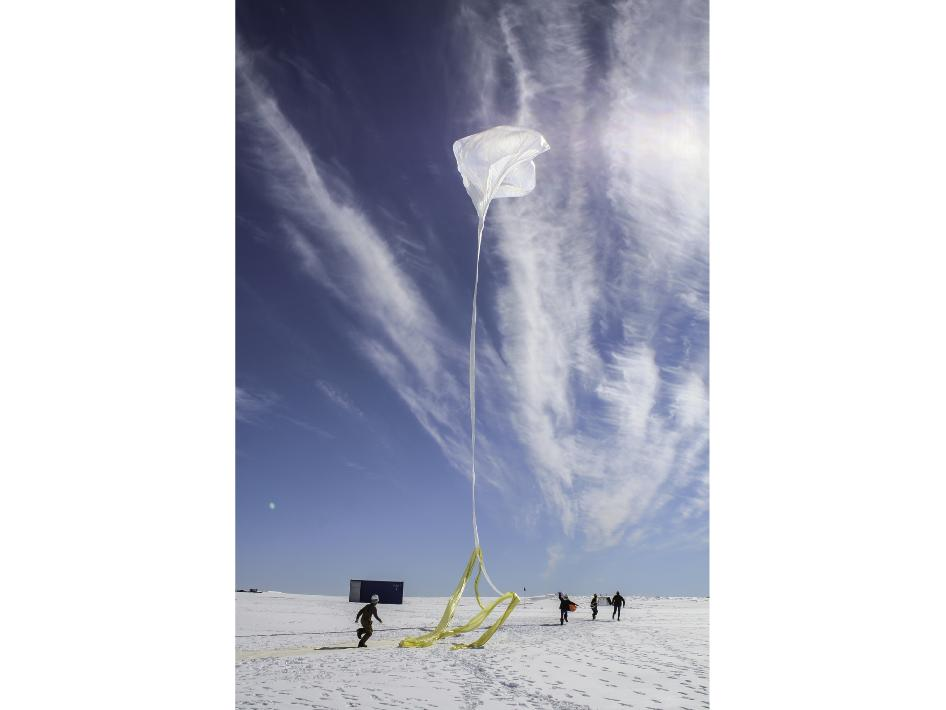 Scientists race through the Antarctic snow to launch one of 20 balloons as part of NASA's BARREL mission.