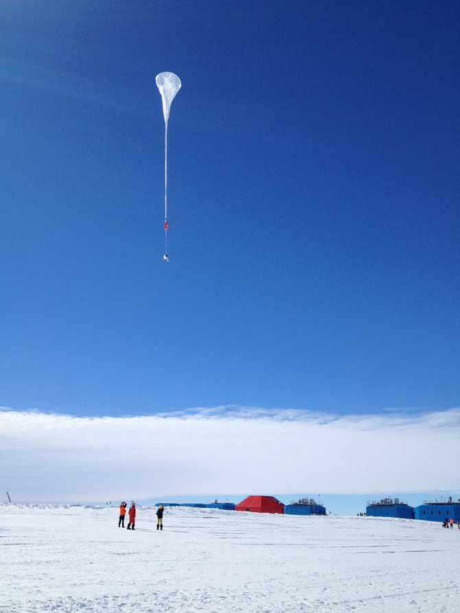 A white balloon floats into the Antarctic sky as part of NASA's BARREL mission.