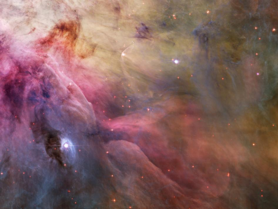 This esthetic close-up of cosmic clouds and stellar winds features LL Orionis, interacting with the Orion Nebula flow.