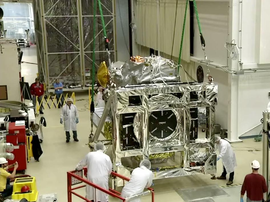 The GPM Core Observatory being removed from the Thermal Vacuum Chamber