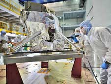 Inspection of the Webb telescope's Mid-Infrared Instrument in the giant clean room at Goddard.