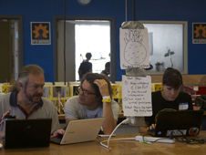 A team in San Francisco puzzles over The Pineapple Project, a software challenge to apply climate data to agricultural planning, during the 2012 International Space Apps Challenge.