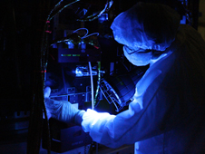 Using a black light, a technician closely inspects one of NASA's Van Allen Probes. Black-light inspection uses UVA fluorescence to detect possible microcontamination, small cracks, or fluid leaks.