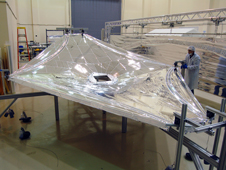 A one-third-scale model of the sunshield was built for testing and refining the team's understanding of thermal issues. Here, one layer of the model undergoes tension testing at the Nexolve facility.