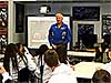 Former astronaut Jon McBride speaks to a group of students