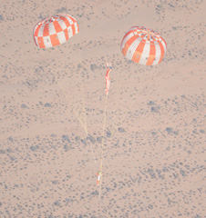 jsc2013e010454 -- NASA'S Orion Lands Safely on Two of Three Parachutes in Test