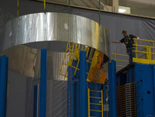 Engineers using a state-of-the-art vertical welding tool at the Marshall Space Flight Center in Huntsville, Ala., move a