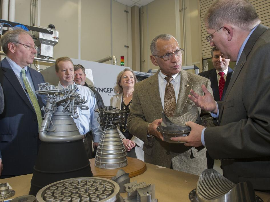 NASA Administrator Charles Bolden looks at models of J-2X and RS-25 rocket engines while talking with Frank Ledbetter, chief of the nonmetallic materials and manufacturing division at NASA's Marshall Space Flight Center in Huntsville, Ala.