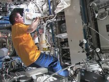 Expedition 34 Commander Kevin Ford works with the Materials Science Laboratory's Solidification and Quenching Furnace, located in the Material Science Research Rack aboard the International Space Station. (NASA TV)