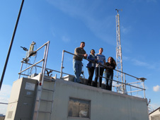 The Penn State University team poses on top of their NATIVE research trailer at the Porterville ground site.
