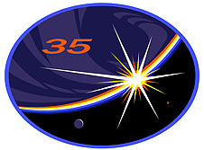 An oval-shaped mission patch featuring a bright sun shining just over the edge of Earth during sunrise. A large numeral 35 appears in the upper left