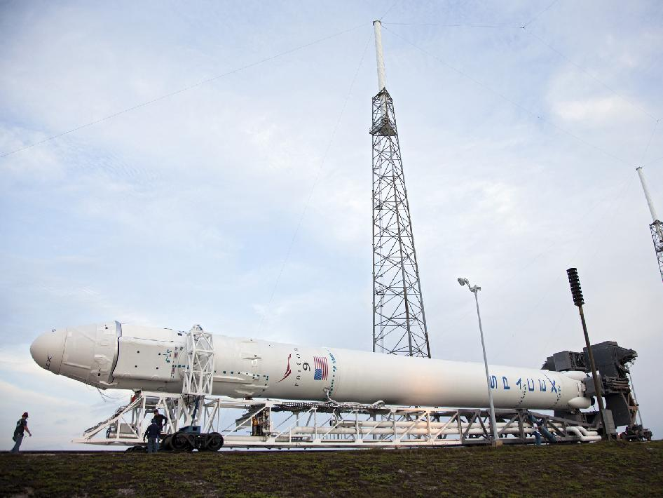 The SpaceX Falcon 9 rocket approaches the launch pad for a test firing of the vehicle's nine Merlin first-stage engines