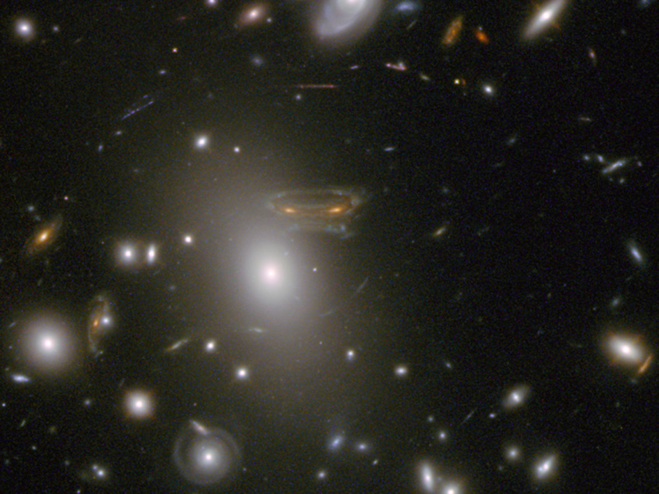 Image of a spiral galaxy stretched and mirrored by the surrounding gravitational field, taken by Hubble's Wide Field Camera 3 and combined with near-infrared observations from Hubble's Advanced Camera for Surveys. Image Credit: NASA/ESA; Acknowledgement: N. Rose