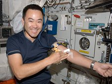 Japan Aerospace Exploration Agency astronaut Akihiko Hoshide, Expedition 32 flight engineer, poses for a photo after undergoing a generic blood draw in the Columbus laboratory. These blood samples are used for various experiments, including ones on nutrition. (NASA)